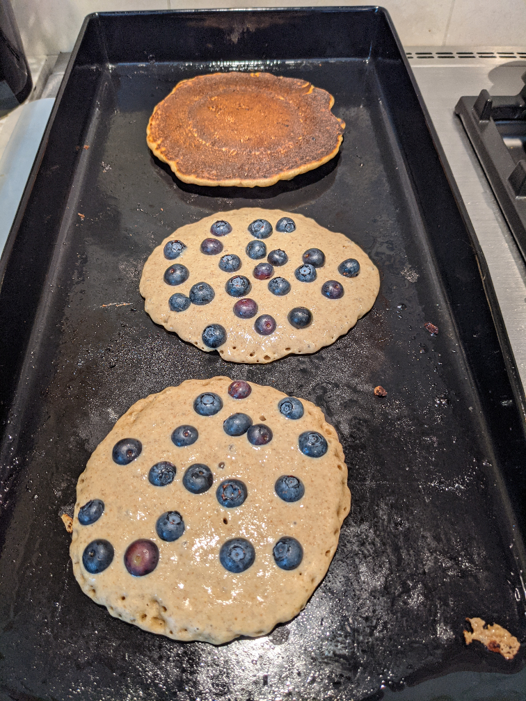 Rye Pancakes cooking on a griddle.